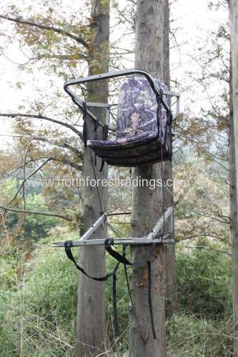 One man hang on tree stand