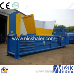 Manual tie baling press