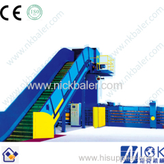 Rigid plastics hydraulic strapping machine