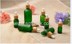 green glass bottle essential oil bottle