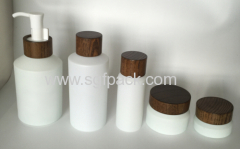 wood cap pump and glass bottle jar