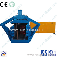 Cardboard twin chamber baler with automatic tie baler