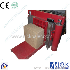Wood shaving bale compactor