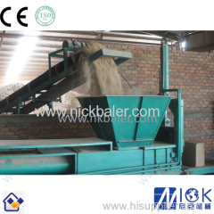 Wood shaving recycling baler for animal pedding