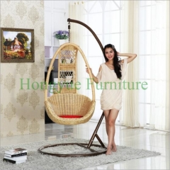 Light yellow rattan hammock with red cushions supplier