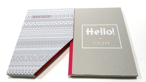 Cloth wrapped spine hardcover book with slipcase