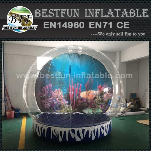 Inflatable small human snow globe
