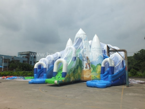 Giant double water slide with mountain climbing