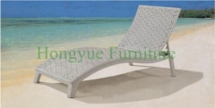 Outdoor white rattan lounge chair for the beach