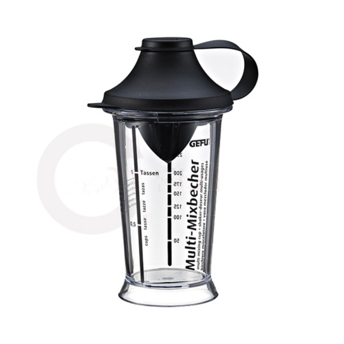 Multi functional mixing cup with lemon juicer