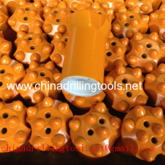 Tungsten carbide button bits for mining