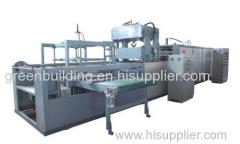 Automatic continuous vacuum forming machine