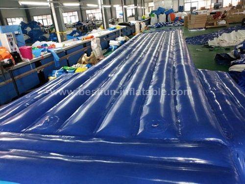 Inflatable floating air tumble track