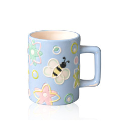 Light blue empaistic ceramic coffee cup with animal print