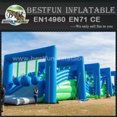 Adults Wrecking Ball in Large Inflatable Obstacle Course