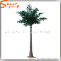 Large outdoor artificial Roystonea regia palm trees