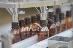 Glass vial filling and capping machine
