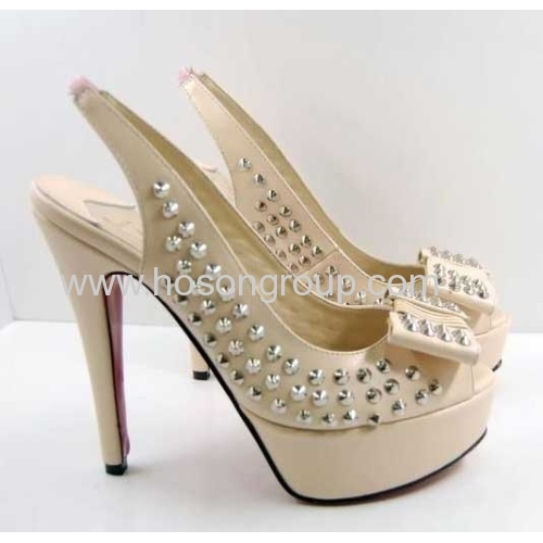 White sling back stiletto heel shoes