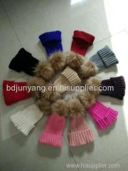 Women knitted beanie hat with big raccoon fur ball