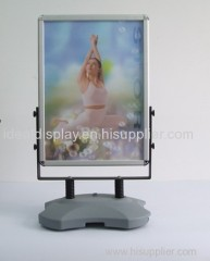 Outdoor poster stand with water tank