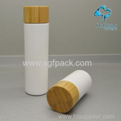 white glass bottle with pump