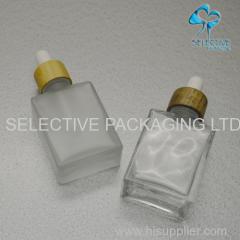 glass bottle and jar with bamboo cap pump sprayer disc cap
