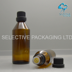 empty tapered brown glass olive oil bottle with plastic screw lids