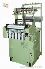 High speed shuttle less ribbon needle loom machine