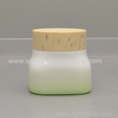 Empty cosmetic opal glass jar wooden lid