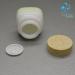 Empty cosmetic opal glass jar wooden lid