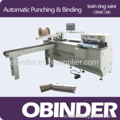 Automatic book punching and binding machine