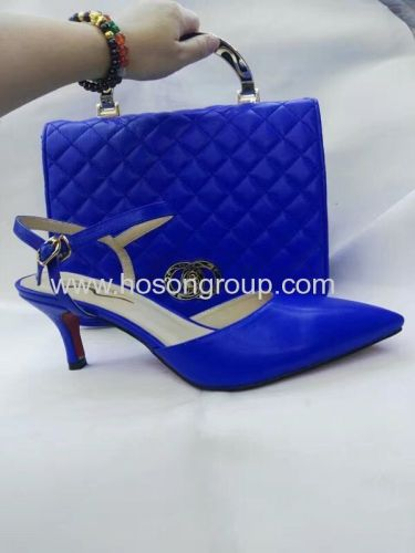 Laides high heel sandals and matched handbag blue