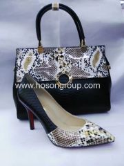 Fashion snake pattern high heel shoes and bags white and black
