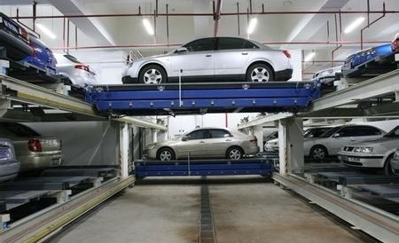 Slide elevator stacker parking system