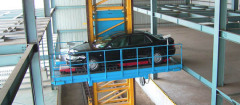 Four column central stacker parking system