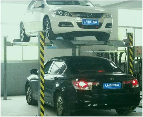 Four-post hydraulic operated car parking lifter