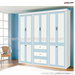 Bright colour wood wardrobe and chest in same color with other furniture in home