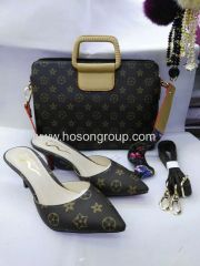 Ladies high heel slipper and matched handbag