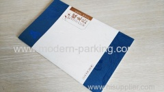thin grid saddle stitched brochure with dust jacket