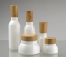 Opal glass lotion bottle and cream jar with bamboo cap