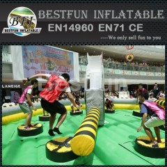 Inflatable meltdown game with rotative machine