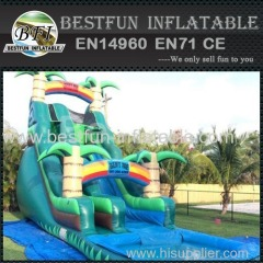 Tobogán inflable verde tropical