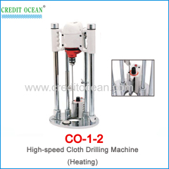 Heating cloth drilling machine