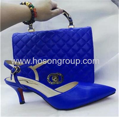 Laides high heel sandals and matched handbag blue