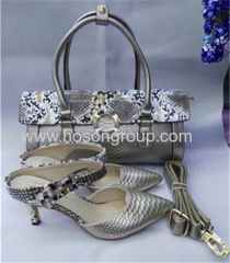 Ladies ankle strap high heel dress shoes and matching bags