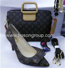 Bowtie ladies high heel shoes and matched handbag