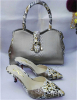 Silver high heel pointed toe shoes with matching handbag