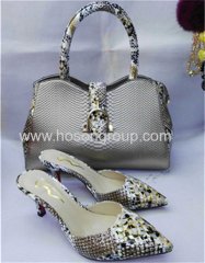 Silver ladies high heel pointed toe shoes with matching handbag
