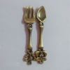 Metal crafted souvenir spoon and fork set