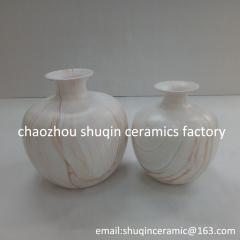 white ceramic vase with marble finish